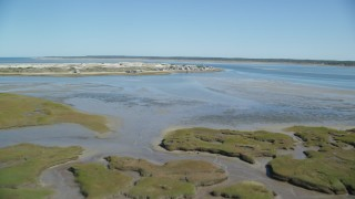 AX143_142 - 6K stock footage aerial video flying over marshland, approach Sandy Neck Colony, Barnstable, Massachusetts