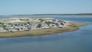 AX143_143 - 6K stock footage aerial video of Sandy Neck Colony, Sandy Neck Light, Cape Cod, Barnstable, Massachusetts