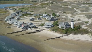 AX143_145 - 6K stock footage aerial video of Sandy Neck Colony, Sandy Neck Light, Cape Cod, Barnstable, Massachusetts