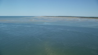 AX143_146 - 6K stock footage aerial video approaching sand bars, low tide, Cape Cod Bay, Massachusetts