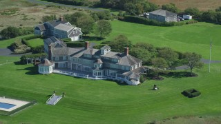 AX143_160 - 6K stock footage aerial video orbiting mansion, Cape Cod, Dennis, Massachusetts