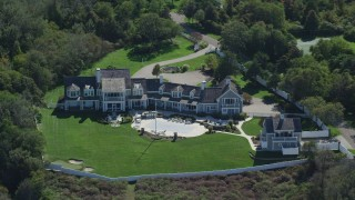 AX143_167 - 6K stock footage aerial video orbiting mansion, Cape Cod, Dennis, Massachusetts