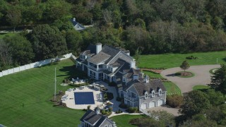 AX143_168 - 6K stock footage aerial video orbiting mansion, swimming pool, Cape Cod, Dennis, Massachusetts