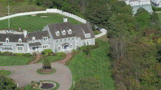 AX143_169 - 6K stock footage aerial video orbiting front of mansion, Cape Cod, Dennis, Massachusetts