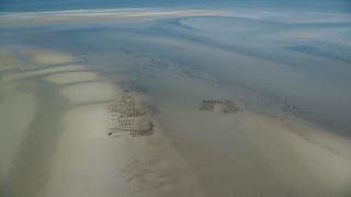AX143_171 - 6K stock footage aerial video flying by oyster farming on sand bars, low tide, Cape Cod, Dennis, Massachusetts