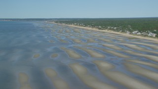 AX143_182 - 6K stock footage aerial video flying over sand bars, approaching small coastal town, Eastham, Massachusetts