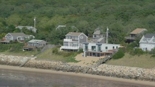 AX143_185 - 6K stock footage aerial video flying by raised beachfront homes, Cape Cod, Eastham, Massachusetts
