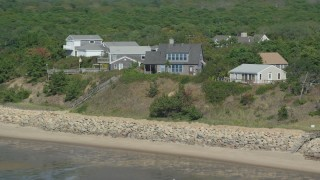 AX143_186 - 6K stock footage aerial video flying by hilltop, beachfront hoes, Cape Cod, Eastham, Massachusetts