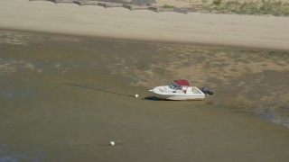 AX143_187 - 6K stock footage aerial video flying by beached fishing boat on sandbar, Cape Cod, Eastham, Massachusetts