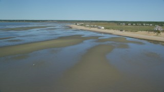 AX143_188 - 6K stock footage aerial video flying over sand bar, by beachfront homes, Cape Cod, Eastham, Massachusetts
