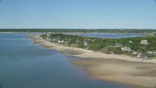 AX143_193 - 6K stock footage aerial video flying over Chipman's Cove, approach beachfront homes, Wellfleet, Massachusetts