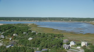 AX143_194 - 6K stock footage aerial video flying over beachfront homes, approach Chipman's Cove, Wellfleet, Massachusetts