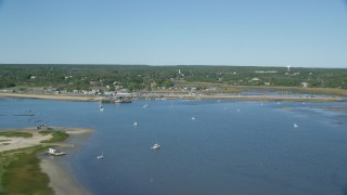 AX143_195 - 6K stock footage aerial video flying over Chipman's Cove, approach Wellfleet Town Pier, Wellfleet, Massachusetts