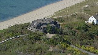 AX143_203 - 6K stock footage aerial video flying by oceanfront home, approaching beach, Cape Cod, Truro, Massachusetts