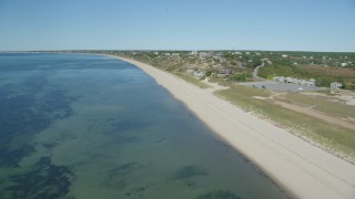 AX143_206 - 6K stock footage aerial video flying over beach, approaching homes, Cape Cod, Truro, Massachusetts