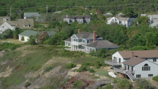 AX143_213 - 6K stock footage aerial video flying by homes with ocean views, panning right, Cape Cod, Truro, Massachusetts