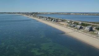 AX143_215 - 6K stock footage aerial video flying over beachfront homes, Highway 6, coastal road, Truro, Massachusetts