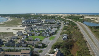 AX143_218 - 6K stock footage aerial video of Highway 6, coastal road, Kalmar Village, Sandcastle Resort and Club, Truro, Massachusetts