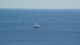 AX143_220 - 6K stock footage aerial video flying by sailing boat, Cape Cod Bay, Massachusetts