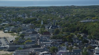AX143_230 - 6K stock footage aerial video flying by small coastal town, Provincetown Town Hall, Provincetown, Massachusetts