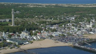 AX143_235 - 6K stock footage aerial video orbiting Pilgrim Monument, Provincetown City Hall, Provincetown, Massachusetts