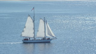 AX143_243 - 6K stock footage aerial video tracking sailing boat on Cape Cod Bay, Massachusetts