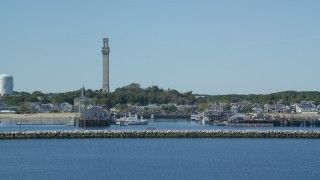 AX143_246 - 6K stock footage aerial video approaching small coastal town, Pilgrim Monument, Provincetown, Massachusetts