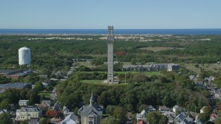 AX143_249 - 6K aerial stock footage video of a small coastal town, approaching Pilgrim Monument, Provincetown, Massachusetts