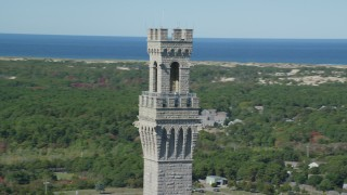AX143_250 - 6K stock footage aerial video orbiting the top of the Pilgrim Monument, Provincetown, Massachusetts