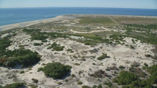 AX143_253 - 6K stock footage aerial video flying by sand dunes, marshland, Cape Cod, Provincetown, Massachusetts