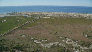 AX143_255 - 6K stock footage aerial video flying by marshland, Cape Cod, Provincetown, Massachusetts