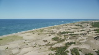 AX144_002 - 6K stock footage aerial video flying over sand dunes, beach, Cape Cod, Provincetown, Massachusetts