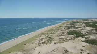 AX144_003 - 6K stock footage aerial video flying over sand dunes, beach, beachfront homes, Provincetown, Massachusetts