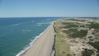 AX144_004 - 6K stock footage aerial video flying over waves rolling onto the beach, Cape Cod, Provincetown, Massachusetts
