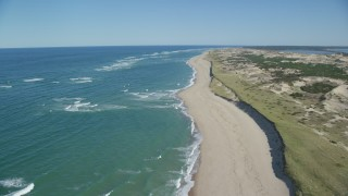 AX144_006 - 6K stock footage aerial video flying over beach, Cape Cod, Provincetown, Massachusetts