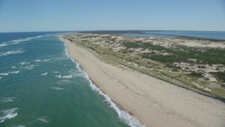 AX144_007 - 6K stock footage aerial video flying by the beach, Cape Cod, Provincetown, Massachusetts