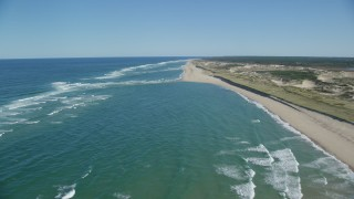 AX144_010 - 6K stock footage aerial video flying over waves rolling onto beach, Cape Cod, Truro, Massachusetts