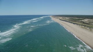 AX144_011 - 6K stock footage aerial video flying over waves rolling onto the beach, Cape Cod, Truro, Massachusetts
