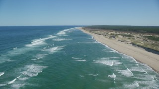 AX144_012 - 6K stock footage aerial video flying over waves rolling onto beach, Cape Cod, Truro, Massachusetts