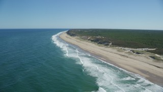 AX144_013 - 6K stock footage aerial video flying by waves crashing, beach, Cape Cod, Truro, Massachusetts