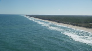 AX144_029 - 6K stock footage aerial video flying by waves crashing onto beaches, Cape Cod, Eastham, Massachusetts