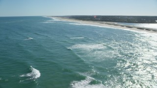 AX144_037 - 6K stock footage aerial video flying low over waves rolling toward beaches, Orleans, Massachusetts