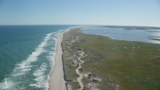 AX144_040 - 6K stock footage aerial video flying over waves crashing, beaches, marshlands, Orleans, Massachusetts