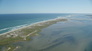 AX144_042 - 6K stock footage aerial video flying by marshlands, beaches, sand bars at low tide, Orleans, Massachusetts