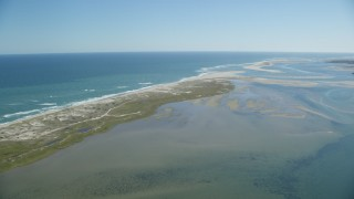 AX144_043 - 6K stock footage aerial video flying by beaches, marshlands, sands bars at low tide, Orleans, Massachusetts