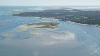 AX144_045 - 6K stock footage aerial video approaching Strong Island, small coastal town, Chatham, Massachusetts