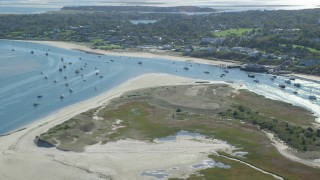 AX144_046 - 6K stock footage aerial video flying over Strong Island, approaching small coastal town, Chatham, Massachusetts
