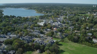AX144_049 - 6K stock footage aerial video flying by small coastal town, Cape Cod, Chatham, Massachusetts
