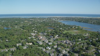 AX144_053 - 6K stock footage aerial video flying by small coastal town near Oyster Pond, Chatham, Massachusetts