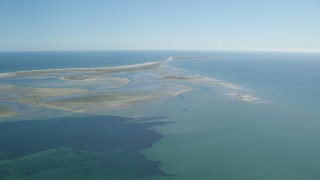 AX144_056 - 6K stock footage aerial video flying by sand bars at low tide and Monomoy Island, Massachusetts